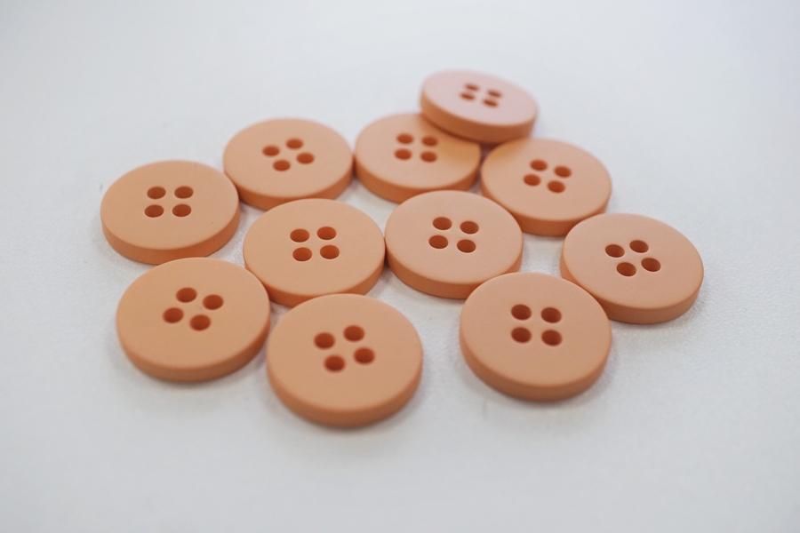 Пуговица плательная пластик светло-персиковая 10 мм PRT-(G)- 08082068