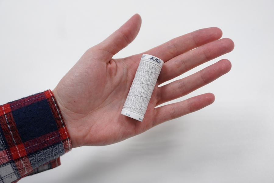 Нитка-резинка приглушенно-белая №1000 Amann Group Mettler 10 м 21042006