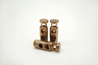 Фиксатор для шнурка металл темное золото 10072134